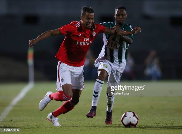 Benfica defender Tyronne Ebuehi from Nigeria with Vitoria Setubal forward Leandro Resinda from Netherlands in action during the PreSeason Friendly...