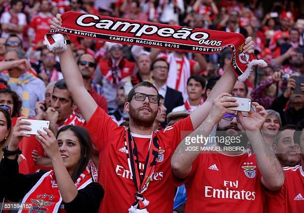 TOPSHOT Benfica fans cheer their team during the Portuguese league football match SL Benfica vs CD Nacional at Luz stadium in Lisbon on May 15 2016 /...