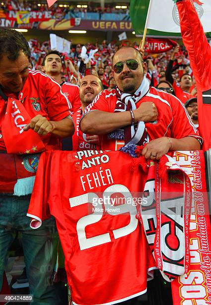 Benfica fans hold a shirt of former player Miklos Feher prior to the UEFA Europa League Final match between Sevilla FC and SL Benfica at Juventus...