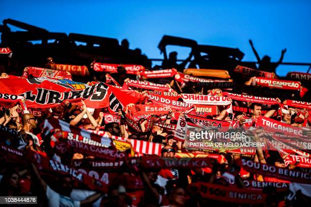 Benfica fans hold up their scarves moments before the Portuguese league football match between SL Benfica and CD Aves at the Luz stadium in Lisbon on...