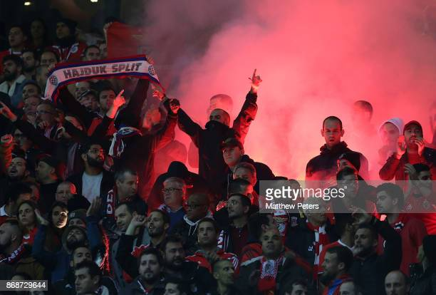Benfica fans let off flares during the UEFA Champions League group A match between Manchester United and SL Benfica at Old Trafford on October 31...