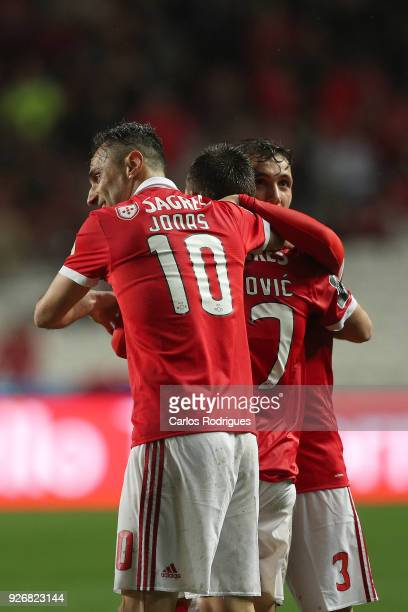 Benfica forward Andrija Zivkovic from Serbia celebrates scoring Benfica fitfh goal with SL Benfica forward Jonas from Brasil and SL Benfica defender...