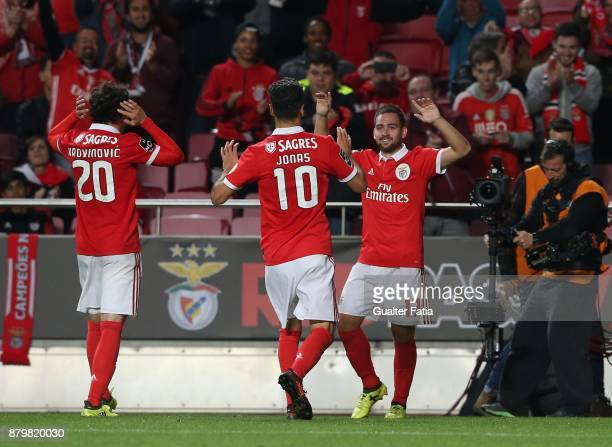 Benfica forward Andrija Zivkovic from Serbia celebrates with teammates after scoring a goal during the Primeira Liga match between SL Benfica and...