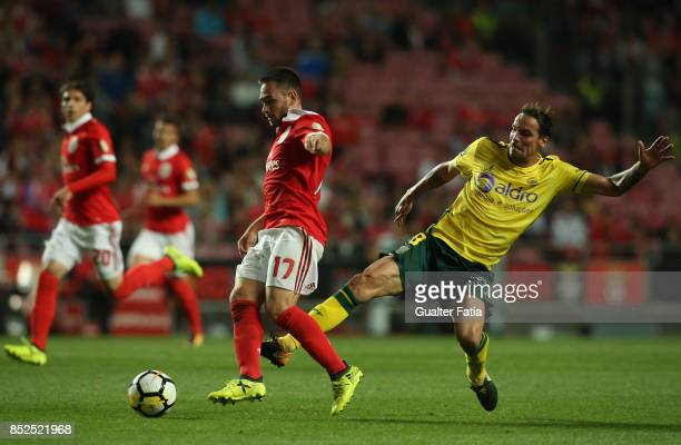 Benfica forward Andrija Zivkovic from Serbia tackled by FC Pacos de Ferreira midfielder Andre Leao from Portugal during the Primeira Liga match...