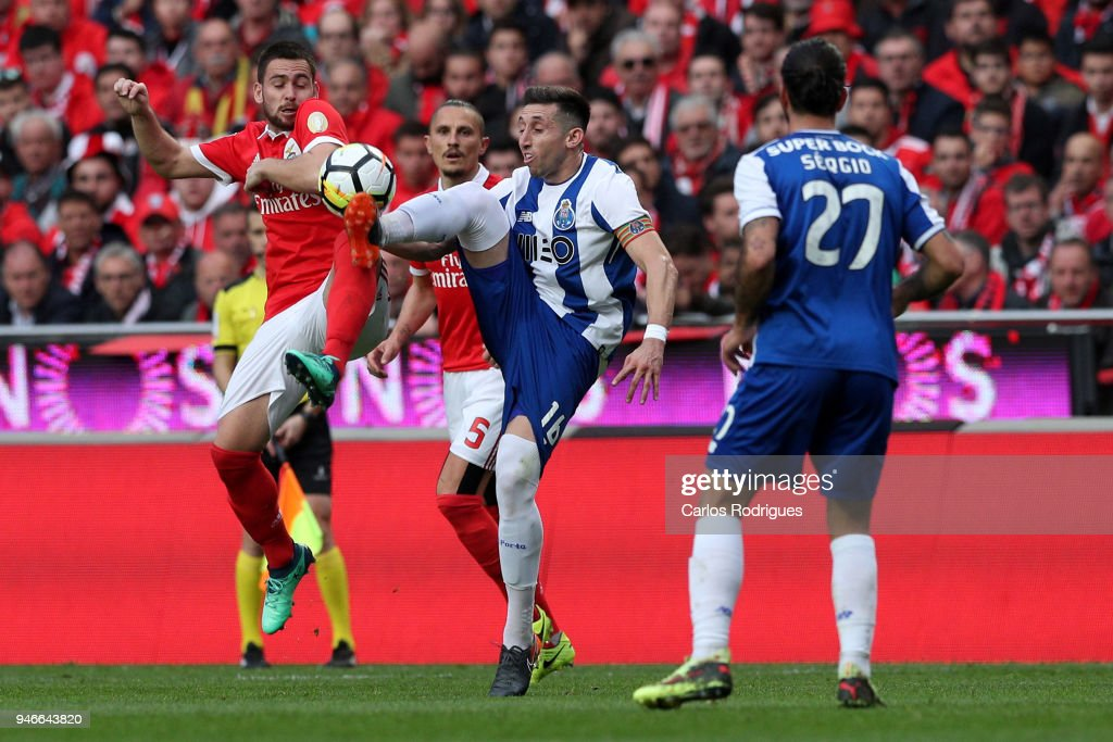 SL Benfica forward Andrija Zivkovic from Serbia (L) vies with FC Porto midfielder Hector Herrera from Mexico (R) for the ball possession during the Portuguese Primeira Liga match between SL Benfica and FC Porto at Estadio da Luz on April 15, 2018 in Lisbon, Lisboa.