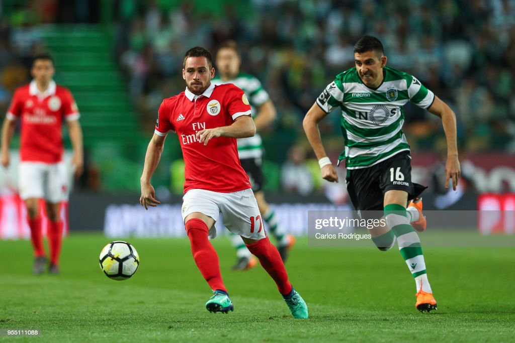 SL Benfica forward Andrija Zivkovic from Serbia (L) vies with Sporting CP midfielder Rodrigo Battaglia from Argentina (R) for the ball possession during the Portuguese Primeira Liga match between Sporting CP and SL Benfica at Estadio Jose Alvalade on May 05, 2018 in Lisbon, Lisboa.