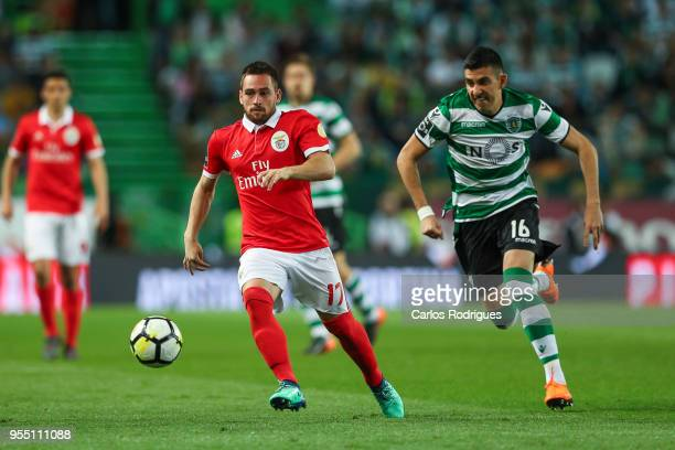 Benfica forward Andrija Zivkovic from Serbia vies with Sporting CP midfielder Rodrigo Battaglia from Argentina for the ball possession during the...