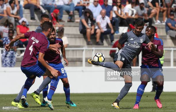 Benfica forward Diogo Goncalves from Portugal with CD Cova da Piedade defender Adilson from Portugal in action during the Segunda Liga match between...
