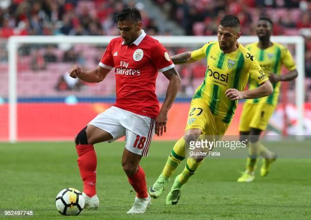 Benfica forward Eduardo Salvio from Argentina with CD Tondela midfielder Bruno Monteiro from Portugal in action during the Primeira Liga match...