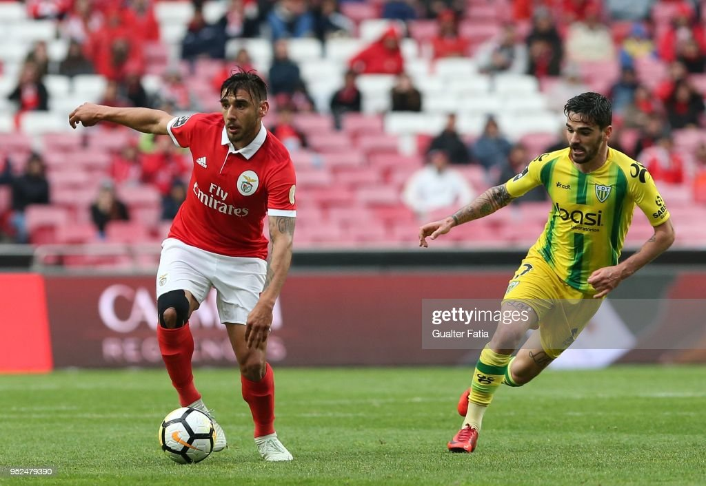 SL Benfica forward Eduardo Salvio from Argentina with CD Tondela midfielder Claude Goncalves from Portugal in action during the Primeira Liga match between SL Benfica and CD Tondela at Estadio da Luz on April 28, 2018 in Lisbon, Portugal.