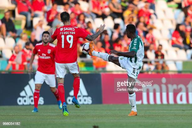 Benfica forward Facundo Ferreyra from Argentina vies with Vitoria Setubal midfielder Jose Semedo from Portugal for the ball possession during the...