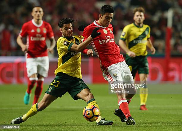 Benfica forward from Mexico Raul Jimenez with Pacos Ferreira's forward Ivo Rodrigues from Portugal in action during the Primeira Liga match between...