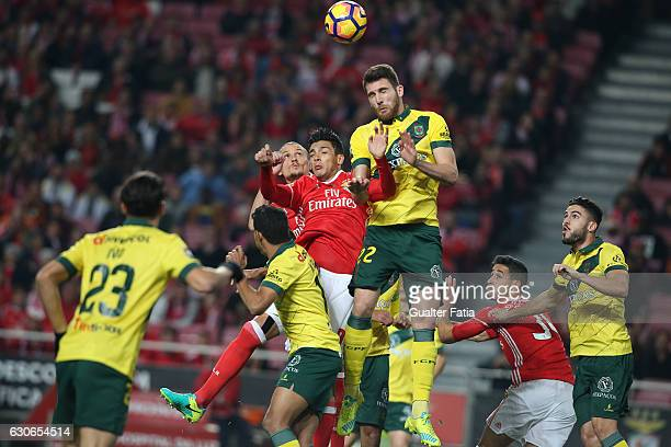 Benfica forward from Mexico Raul Jimenez with Pacos Ferreira's defender Miguel Vieira from Portugal and SL Benfica midfielder from Serbia Ljubomir...