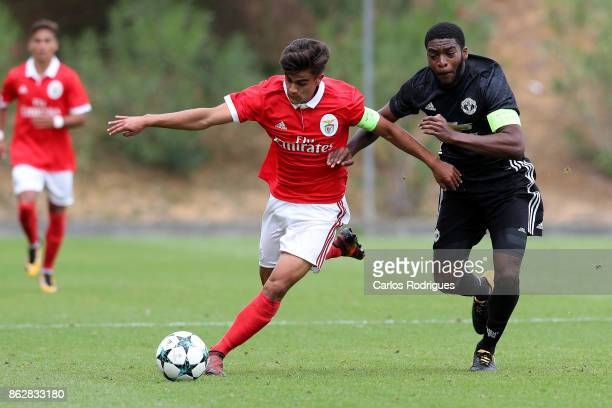 Benfica forward Joao Filipe from Portugal vies with Manchester United defender Ro Shaun Williams from England for the ball possession during SL...
