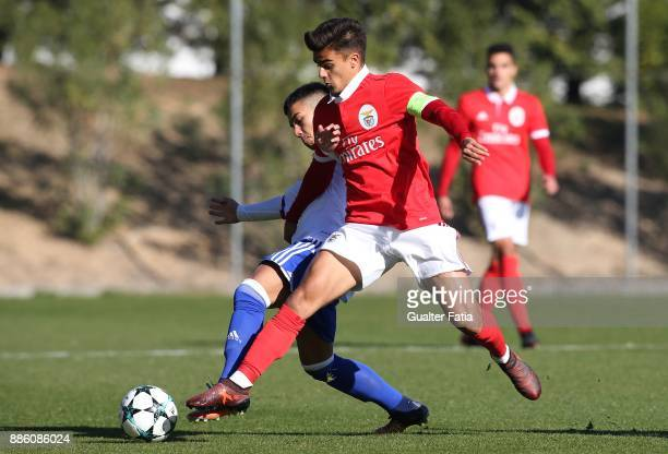 Benfica forward Joao Filipe from Portugal with Basel midfielder Gezim Pepsi from Switzerland in action during the UEFA Youth League match between SL...