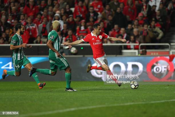 Benfica forward Jonas from Brasil tries to escape Rio Ave FC defender Marcelo from Brazil and Rio Ave FC defender Marcao from Brazil during the match...