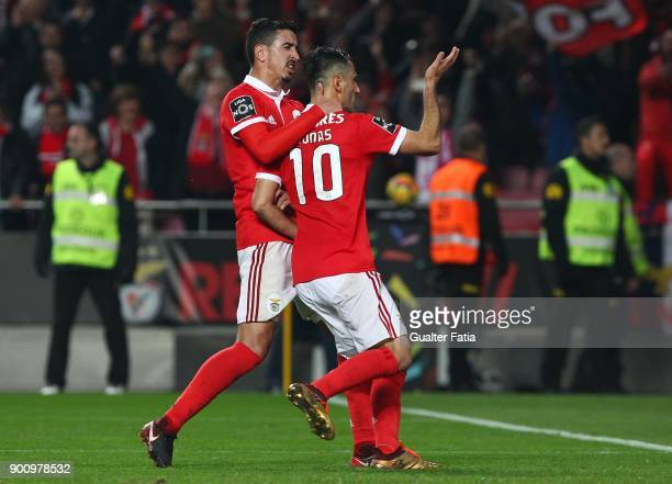 Benfica forward Jonas from Brazil celebrates with teammate SL Benfica defender Andre Almeida from Portugal after scoring a goal during the Primeira...