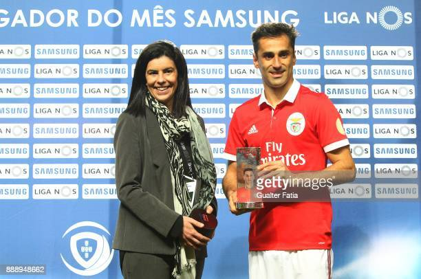 Benfica forward Jonas from Brazil receives the trophy for Best Player in the month of November in the Portuguese Primeira Liga before the start of...