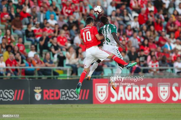 Benfica forward Jonas from Brazil vies with Vitoria Setubal midfielder Jose Semedo from Portugal for the ball possession during the match between SL...