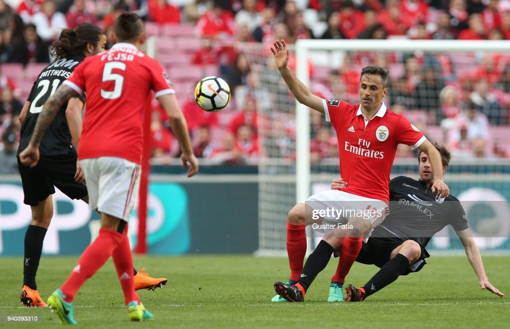 SL Benfica forward Jonas from Brazil with Vitoria Guimaraes midfielder Rafael Miranda from Brazil in action during the Primeira Liga match between SL Benfica and Vitoria Guimaraes at Estadio da Luz on March 31, 2018 in Lisbon, Portugal.