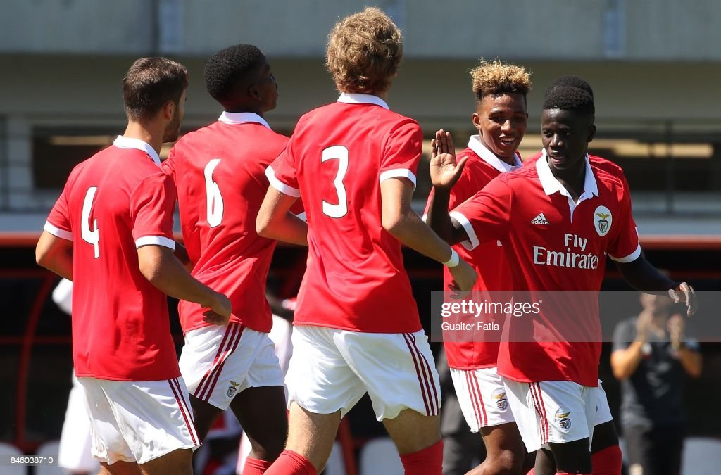 SL Benfica forward Jose Gomes celebrates with teammates after scoring a goal during the UEFA Youth League match between SL Benfica and CSKA Moskva at Caixa Futebol Campus on September 12, 2017 in Seixal, Portugal.