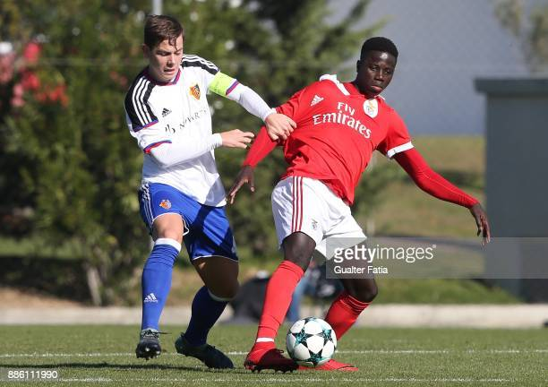 Benfica forward Jose Gomes from Portugal with Basel defender Yves Kaiser from Switzerland in action during the UEFA Youth League match between SL...