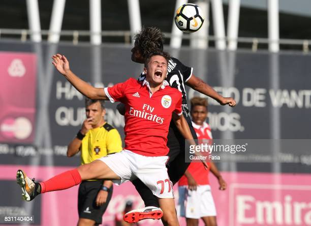 Benfica forward Nuno Santos from Portugal with CD Nacional midfielder Christian in action during the Segunda Liga match between SL Benfica B and CD...