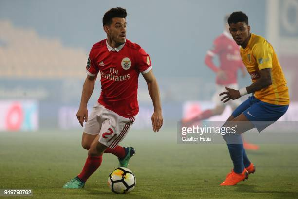 Benfica forward Pizzi from Portugal with GD Estoril Praia defender Ailton Silva from Brazil in action during the Primeira Liga match between GD...