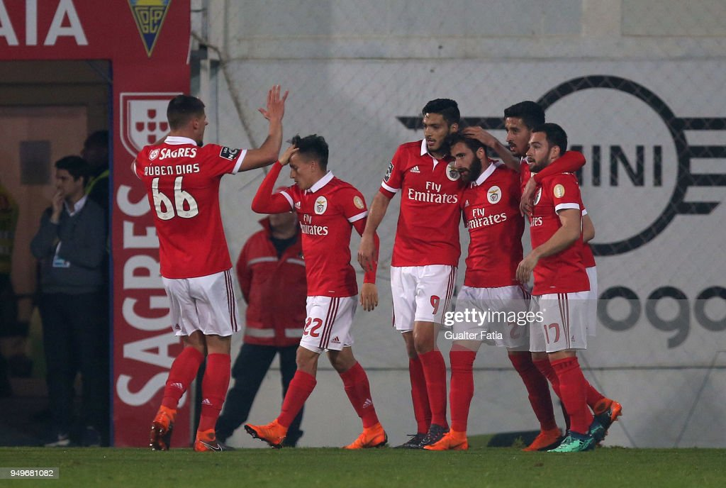SL Benfica forward Rafa Silva from Portugal celebrates with teammates after scoring a goal after scoring a goal during the Primeira Liga match between GD Estoril Praia and SL Benfica at Estadio Antonio Coimbra da Mota on April 21, 2018 in Estoril, Portugal.