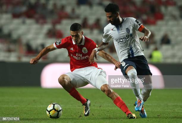 Benfica forward Raul Jimenez from Mexico with CD Feirense midfielder Babanco from Cape Verde in action during the Primeira Liga match between SL...