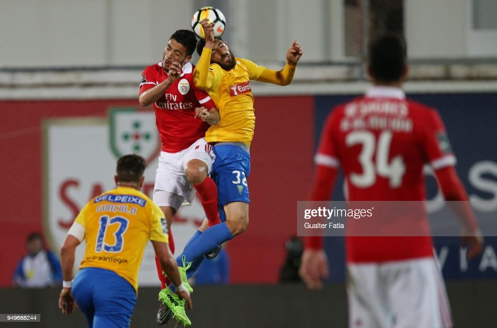 SL Benfica forward Raul Jimenez from Mexico with GD Estoril Praia defender Rafik Halliche from Algeria in action during the Primeira Liga match between GD Estoril Praia and SL Benfica at Estadio Antonio Coimbra da Mota on April 21, 2018 in Estoril, Portugal.