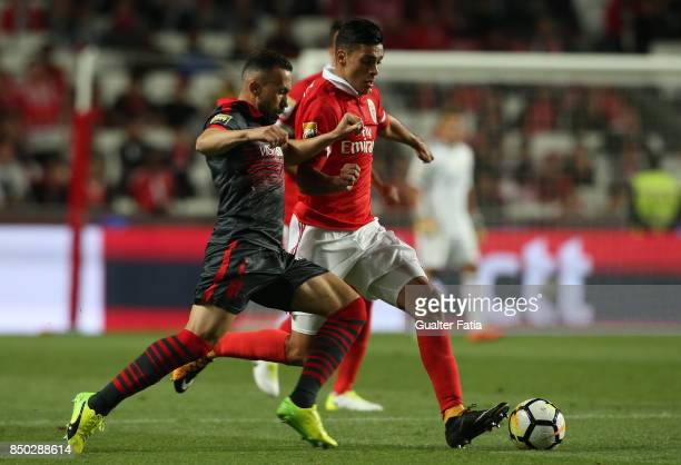 Benfica forward Raul Jimenez from Mexico with SC Braga defender Jefferson from Brazil in action during the Portuguese League Cup match between SL...