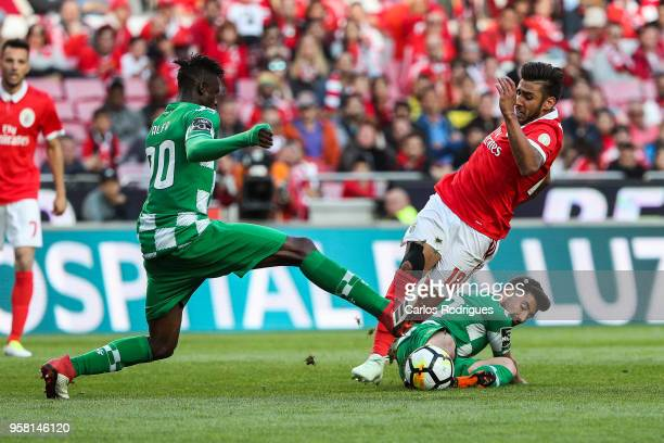 Benfica forward Toto Salvio from Argentina tackled by Moreirense FC forward Toze from Portugal and Moreirense FC midfielder Alfa Semedo from Guine...