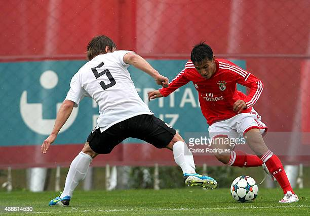Benfica foward Joao Carvalho tries to escape Shakhtar defender Volodymyr Grachov during the UEFA Youth League Quarter Final between SL Benfica and...