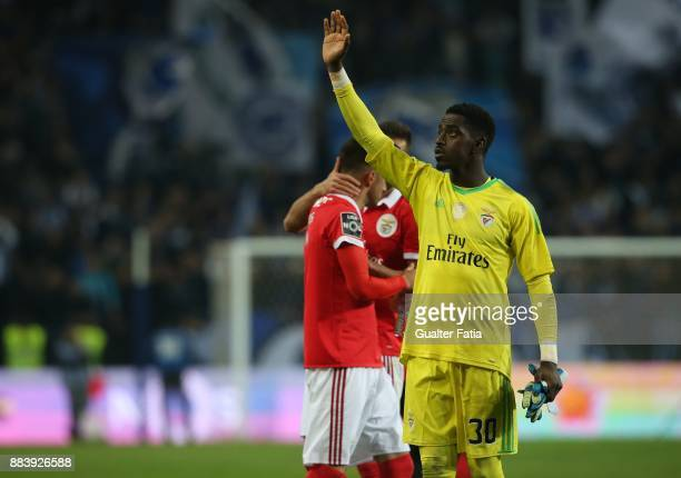 Benfica goalkeeper Bruno Varela from Portugal celebrates with supporters after the draw at the end of the Primeira Liga match between FC Porto and SL...