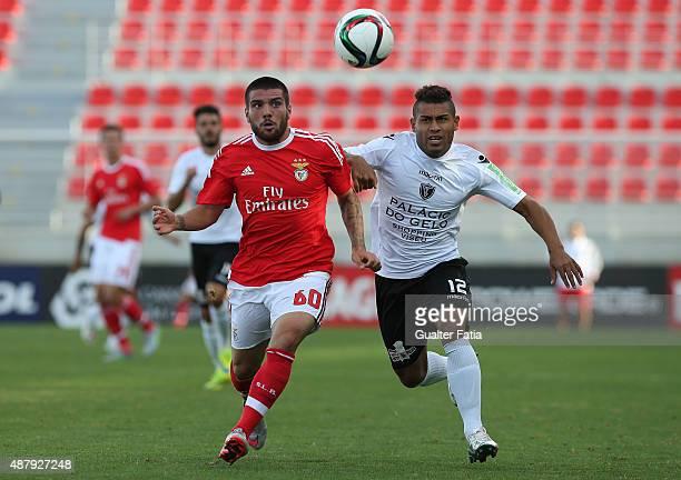 Benfica II's defender Pedro Rebocho with Academica de Viseu's forward Yuri in action during the Primeira Liga match between SL Benfiva II and...