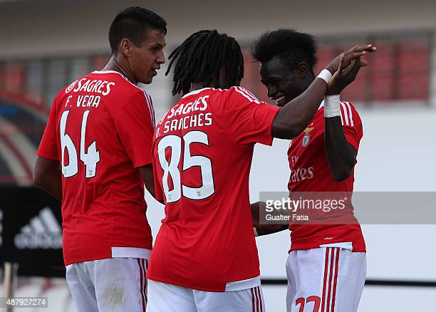 Benfica II's forward Sancidino Silva celebrates with teammates after scoring a goal during the Primeira Liga match between SL Benfiva II and...