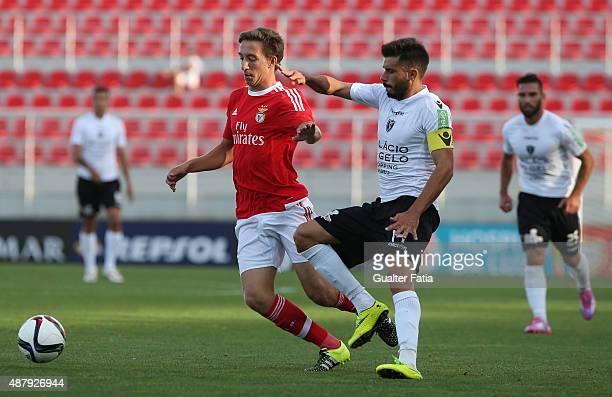 Benfica II's midfielder Filipe Ferreira with Academica de Viseu's midfielder Tome in action during the Primeira Liga match between SL Benfiva II and...
