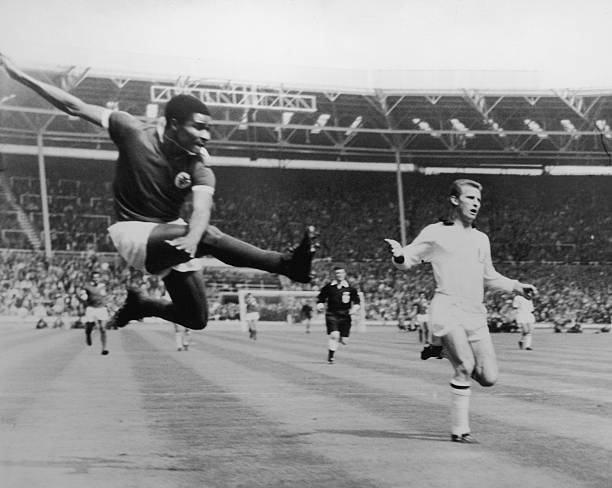 Benfica inside-left Eusebio da Silva Ferreira takes a flying kick to score the first goal of the match 18 minutes into the European Cup final against...