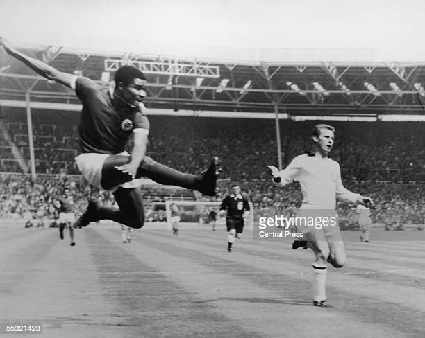 Benfica insideleft Eusebio da Silva Ferreira takes a flying kick to score the first goal of the match 18 minutes into the European Cup final against...
