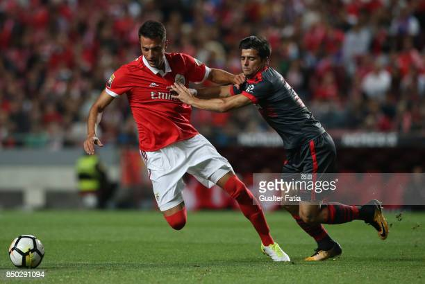 Benfica midfielder Andreas Samaris from Greece with SC Braga forward Joao Carlos Teixeira from Portugal in action during the Portuguese League Cup...