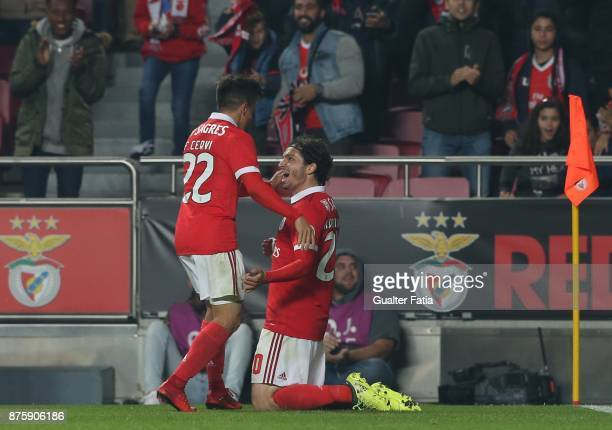 Benfica midfielder Filip Krovinovic from Croatia celebrates with teammate SL Benfica forward Franco Cervi from Argentina after scoring a goal during...
