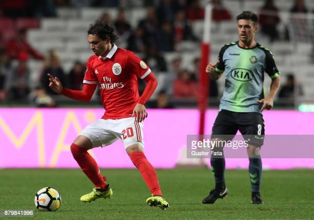 Benfica midfielder Filip Krovinovic from Croatia with Vitoria Setubal midfielder Nene Bonilha from Brazil in action during the Primeira Liga match...