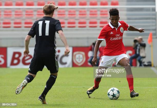 Benfica midfielder Gedson Fernandes with Manchester United FC midfielder Indy Boonen in action during the UEFA Youth League match between SL Benfica...