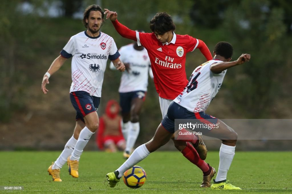 SL Benfica midfielder Joao Felix from Portugal with UD Oliveirense midfielder Kevin Pina from Cape Verde in action during the Segunda Liga match between SL Benfica B and UD Oliveirense at Caixa Futebol Campus on January 13, 2018 in Seixal, Portugal.