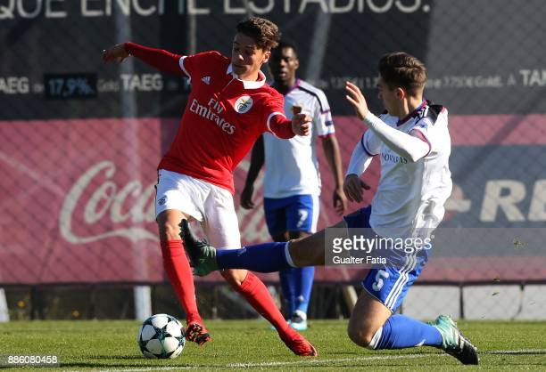 Benfica midfielder Nuno Santos from Portugal with Basel defender Ylber Lokaj from Germany in action during the UEFA Youth League match between SL...