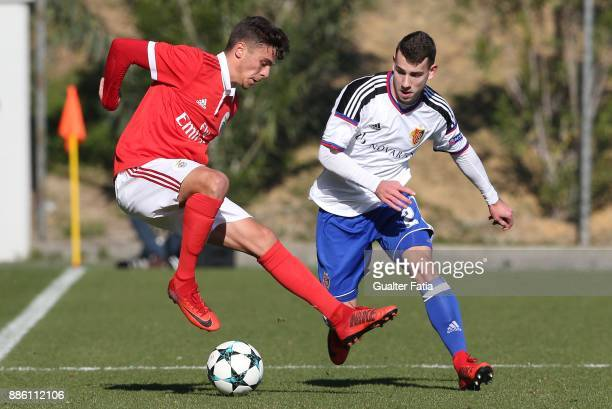 Benfica midfielder Nuno Santos from Portugal with Basel defender Mattia Celant from Switzerland in action during the UEFA Youth League match between...