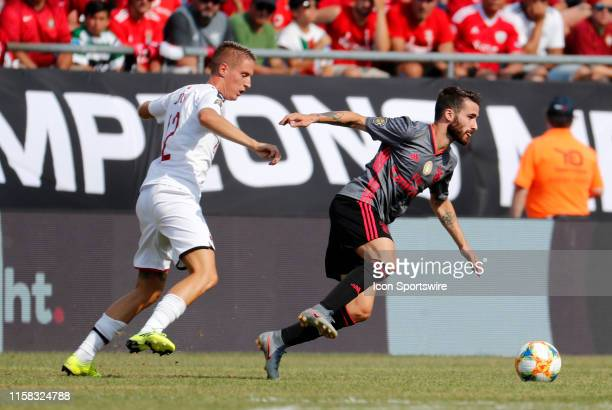 Benfica midfielder Rafa gets away from AC Milan defender Andrea Conti during an International Champions Cup match between AC Milan of Italy and SL...