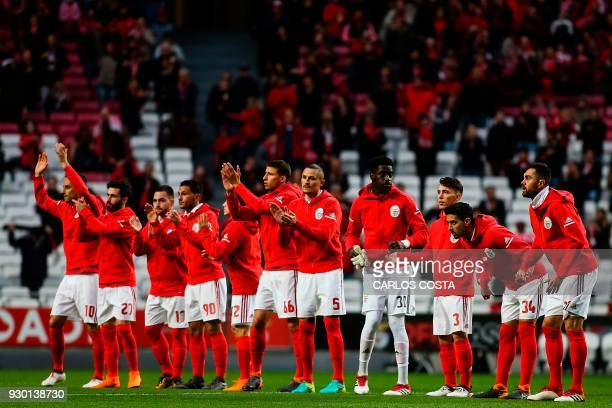 Benfica players acknowledge supporters during the Portuguese league football match between SL Benfica and CD Aves at the La Luz stadium in Lisbon on...