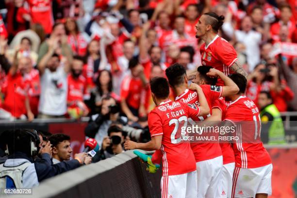 Benfica players celebrate a goal during the Portuguese league football match SL Benfica vs Vitoria Guimaraes SC at the Luz stadium in Lisbon on May...